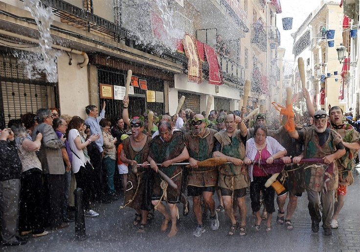 Residents pour water over participants in the traditional Corpus Christi procession in Valencia on June 2, 2013.