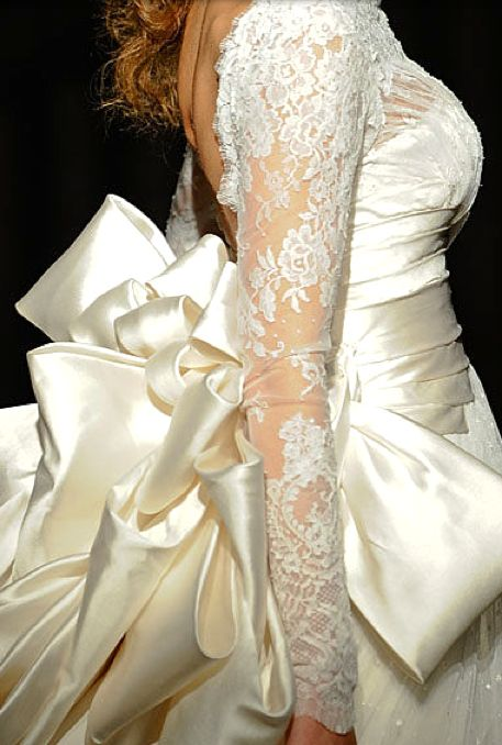 Rami Al Ali....a lovely attire to walk down the aisle in.,bow,satin and lace