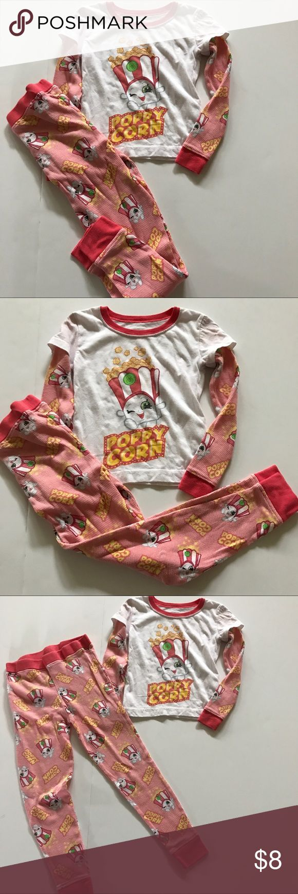 Moose Shopkins poppy corn pjs Moose Shopkins poppy corn pjs. Top is white with pink/red waffle type sleeves with popcorn on them. There is a small stain on front as shown in pic. Pants are pink/red with poppy corn on them. Show wash wear Moose Pajamas Pajama Sets
