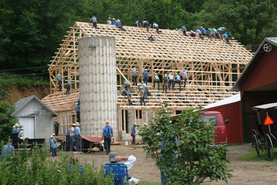 Barn raising. The Amish work together and can put up a barn in no time flat!