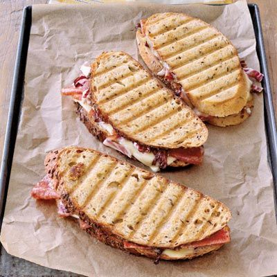 Reminiscent of a grilled cheese, a panini is filled with combos of meat, cheese, and vegetables. The snack is pressed and grilled, either with a cast-iron weight in a grill pan or with a panini maker, yielding a dense texture and a savory flavor. Recipe: Salami and Cheese Panini   - CountryLiving.com