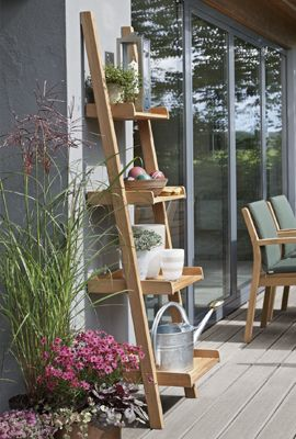 garden shelves - Google Search. Picture along a narrow pathway along side of the house outside of bedroom window.