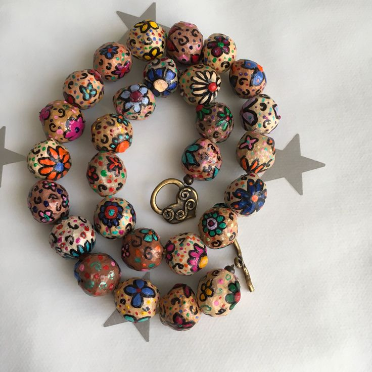 A personal favorite from my Etsy shop https://www.etsy.com/il-en/listing/550214617/papaer-mache-flower-beads-necklace