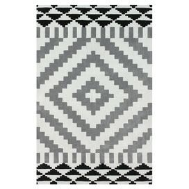 Hand-tufted rug with a Southwestern motif.  Product: RugConstruction Material: PolyesterColor: Light greyFeatures: Hand-tuftedNote: Please be aware that actual colors may vary from those shown on your screen. Accent rugs may also not show the entire pattern that the corresponding area rugs have.Cleaning and Care: Spot treat with a mild detergent and water. Professional cleaning is recommended if necessary.
