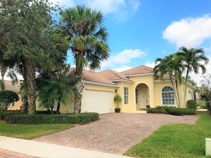 Beautiful and spotless 3 bedroom home that has only been used as a second home. Fabulous upgrades such as impact windows, accordion hurricane shutters, brand new 3 ton AC unit and an extended screened patio, wood flooring throughout and so much more. FOR MORE INFORMATION OR TO SCHEDULE AN APPOINTMENT PLEASE CALL CURRIE REALTY GROUP AT (561) 385-1111. #CurrieRealtyGroup #villagewalk #WellingtonhomesforSale #WestPalmBeach #PalmBeachRealEstate #GreatView #Whataview