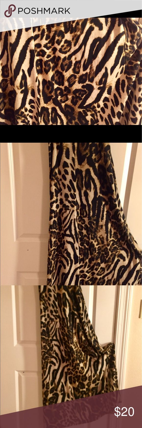 Sexy Cheetah Leopard Print Maxi Halter Dress S M Sexy Maxi Halter Dress. Cheetah Leopard Animal Print. No tags. This will fit both women's SMALL & MEDIUM (it has some give to it.) If you're a curvy small or if you're a medium who wants the eye to cling to your feminine features 😘 it should work nicely. Flattering, slenderizing, comfortable, & made even MY booty look great! (I never wore it out. Only tried it on, cut off the tags & ignored it in my closet for 3 years!) Day dress to date…