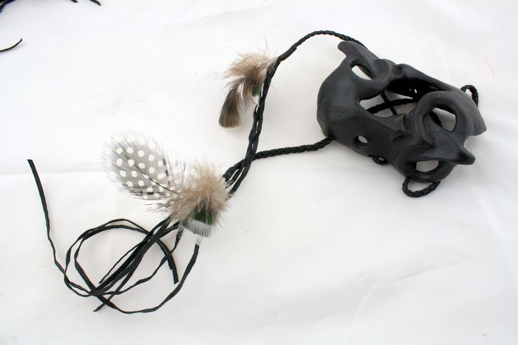 Wheku Cuff .. Patinated Silicon Bronze, Waxed leather, pheasant and kereru feathers .. Jen Waterson, 2014