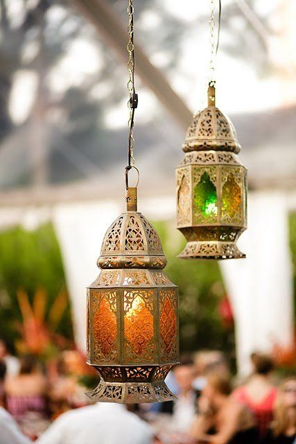 Green and red lanterns hang in a Middle Eastern style to detail this gorgeous wedding with many different influences.