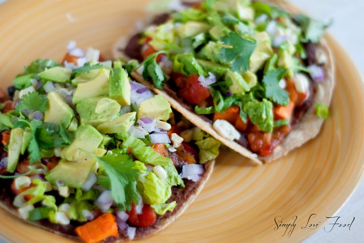 Mexican tostadas, baked in the oven for 8-9 minutes.  A vegetarian recipe with lots of suggestions on ways to change it up from Simply Love Food