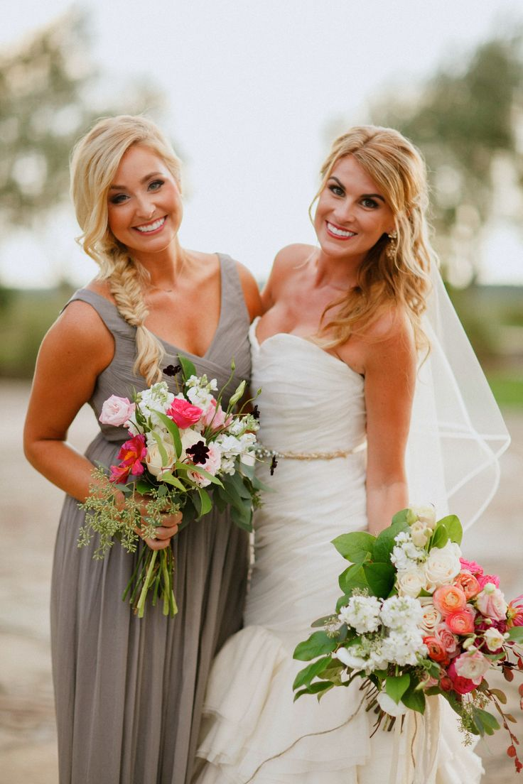 lush and loosely tied bridal and bridesmaids bouquets. the bride carries her ombre bouquet of hot pink dahlia, pink garden roses, cream roses, light pink ranunculus, white ranunculus, white stock, pink lisianthus, seeded eucalyptus and lemon leaf.