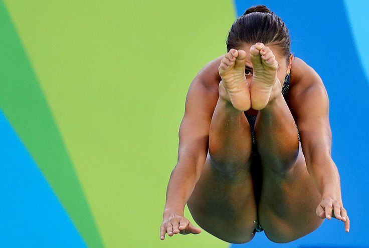 Eye on the prize:    United States' Kassidy Cook dives during a training session at the Maria Lenk Aquatic Center Aug. 11.