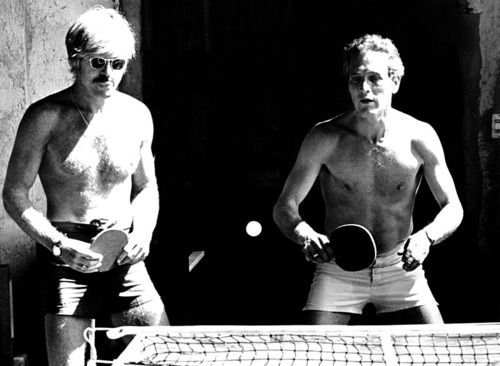 Paul Newman and Robert Redford playing ping pong in short shorts