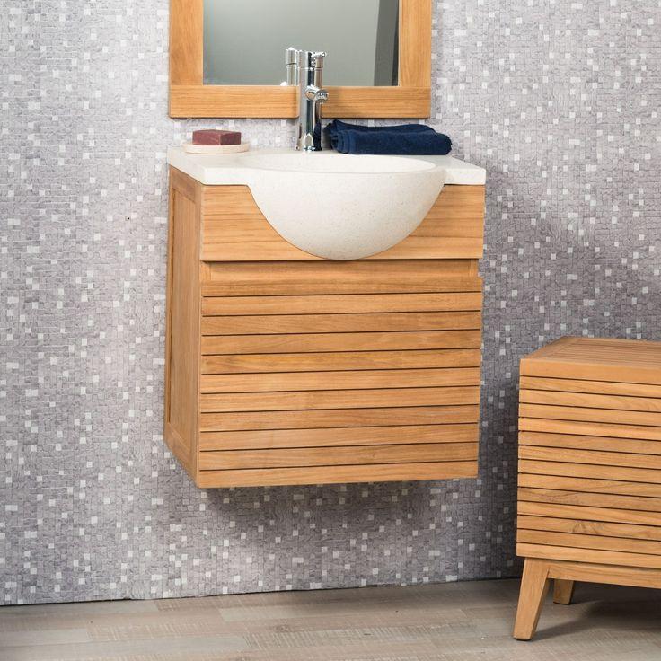 Embellissez votre salle de bain avec ce meuble teck salle de bain suspendu au style contemporain. Il est fabriqué avec du teck massif et de terrazzo pour créer cette ensemble d'espace de rangement très décoratif. Sous la vasque, vous avez la possibilité d'y ranger vos serviettes et accessoires divers. Vendu hors robinetterie Dimensions meuble Longueur : 50 cm Hauteur : 52 cm Profondeur : 40 cm Dimensions vasque Diamètre : 40 cm Longueur : 50 cm Hauteur : 12 cm Profondeur : 50 cm