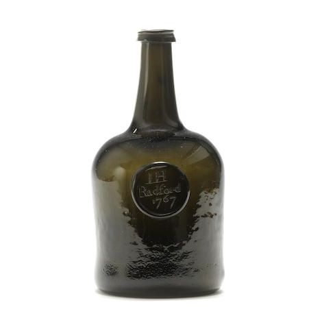 A small sealed cylinder wine bottle, dated 1767