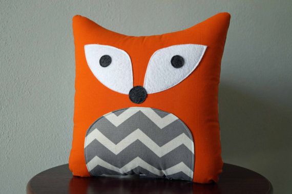 Chevron Fox Pillow This sweet little fox has an orange cotton body with patterned belly, felt eyes (to make him safe for little ones), and a patterned back. My animal pillows are made with 100% cotton Fabrics, and quality Polyfill. Spot cleaning is recommended. Measures approx. 10 inches (25.4 cm) tall and 9 inches (22.86 cm) wide. *Pattern placement may vary* Click here to see more animal pillows: https://www.etsy.com/shop/ATwistedThread?section_id=18810478&ref=shopsection_leftnav_10 ...