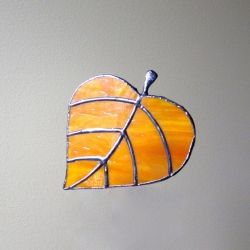 In the meanwhile, I made a falling leaf of my own.  Here it is, artfully photographed suspended in mid-air.