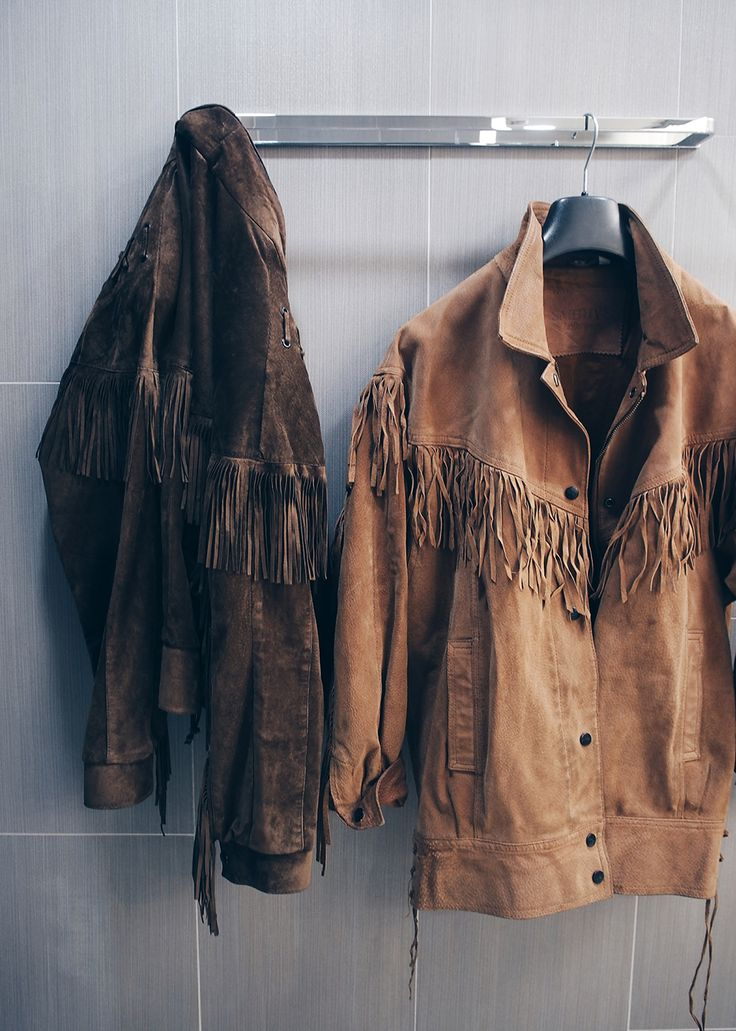 Two fringed suede jackets