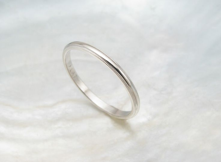 dainty wedding ring -- women's platinum wedding band with milgrain by RavensRefuge on Etsy https://www.etsy.com/listing/127283909/dainty-wedding-ring-womens-platinum