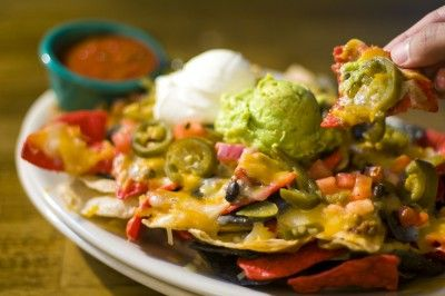 Super Nachos The Super Nachos recipe is a Mexican appetizer or main dish that feeds a crowd. More than just cheese and chips, layer upon layer of goodies makes this a Mexican party or big-game favorite.