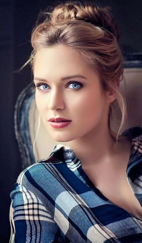 Blonde and blue eyes.