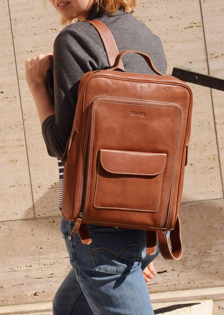Functional and elegant leather laptop backpack by #TheLeatherExpert with multiple pockets, protective laptop sleeve and bottom studs.