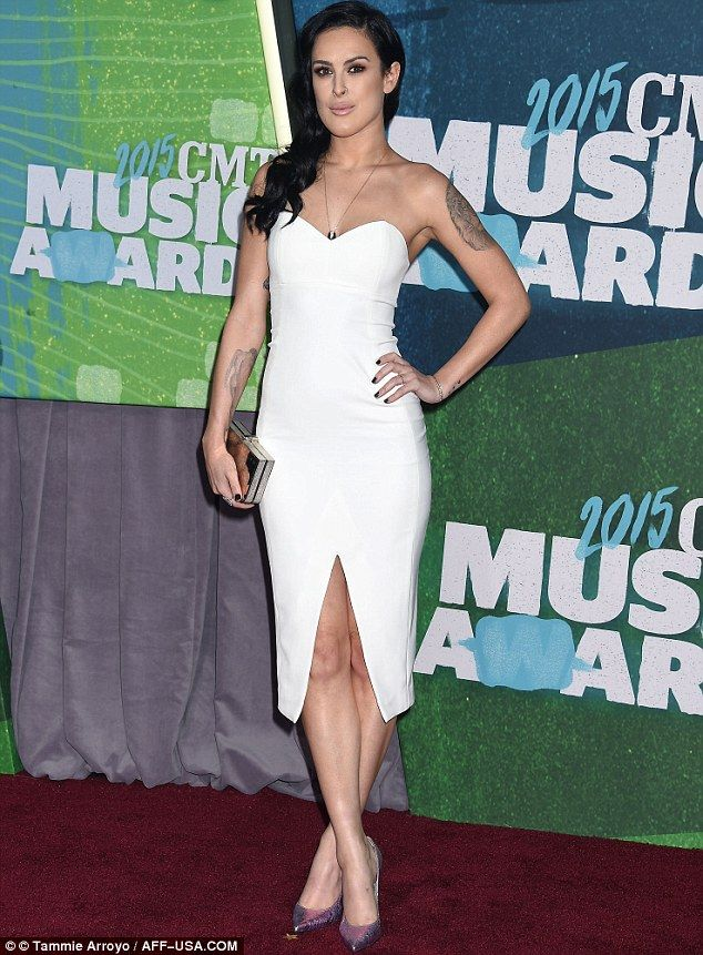Brunette beauty: As the 26-year-old star is not associated with country music at all, she definitely brought some Hollywood glamour to the event