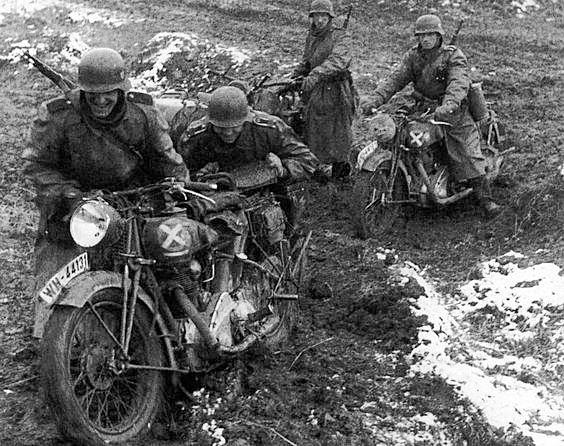 Russian roads WW2. German motorcyclists push bike.