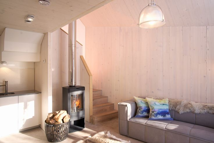 Architect designed holiday house in the Pentland Hills Regional Park near Edinburgh. Westside Woodshed build using CLT timber, with oak & plywood detailing  Architect: Roxburgh McEwan  Modern Architecture Scotland, Nominated for a Saltire Architecture Award  Sofa: Homer Edinburgh, Cushions: Bluebellgray Stove: Aga Basket: Cox&Cox Paint/ oil: Osmo oil Flooring: Russwood Kitchen: IKEA Reindeer hide rug Polished concrete floor