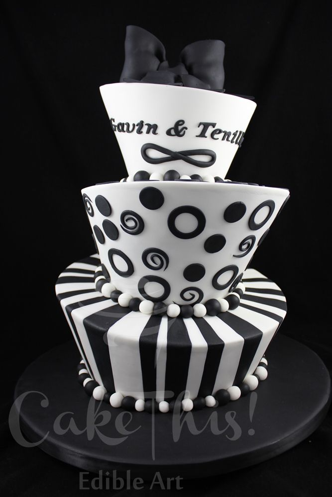 Mad Hatter Wedding Cake - A non conventional black and white themed mad hatter wedding cake with 3 different flavours.