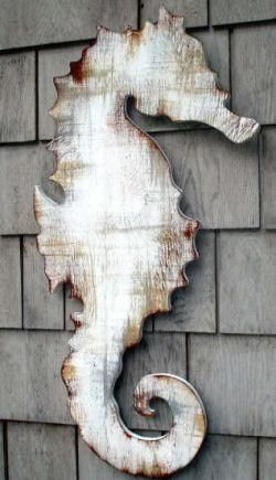 antiqued wooden seahorse plaque.  Would love to have this hanging on my dinning room wall. This would be easy to do - draw on a piece of thin sheeting (plywood) and then paint white, sand paper some of it off.  Make a wash w/ brown paint & water... lightly apply.
