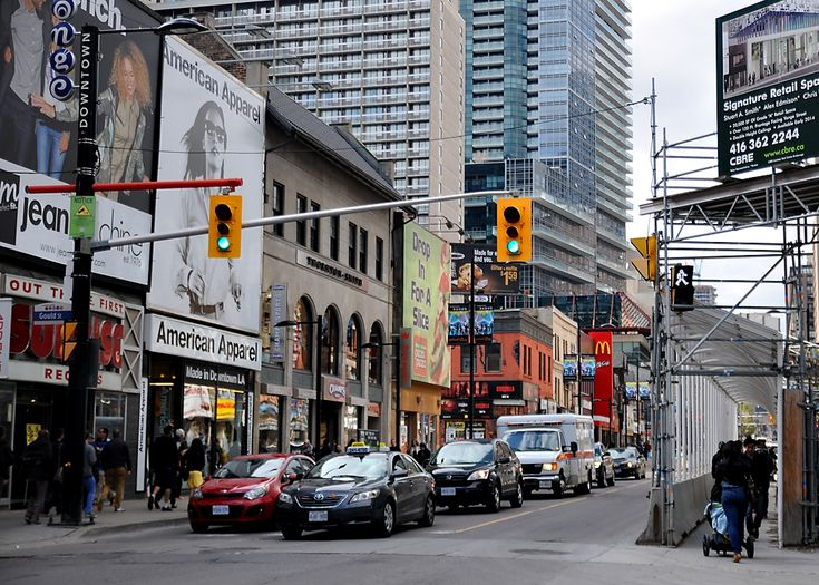 Traffic towards the energetic Dundas Square in Toronto