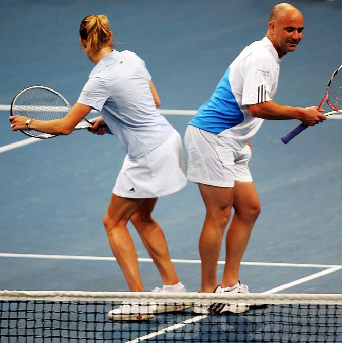 Steffi Graf & husband Andre Agassi doing their version of a happy dance.
