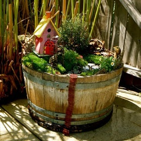 let the children play: fairy gardens, something Patricia and I can do with that barrel planter if it isn't too rotted.