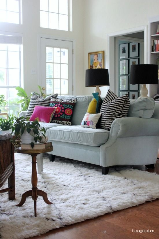 Eclectic Home Tour of Hi Sugarplum - love this gorgeous living room with pale blue sofa and colorful pillows eclecticallyvintage.com