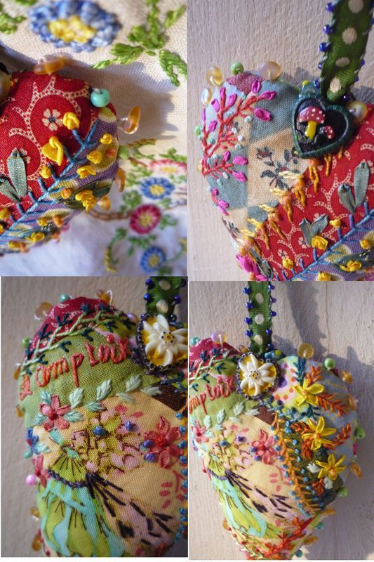 Heart-shaped decorations by Facile Cecile. Various printed fabrics sewn together and embellished with embroidery.