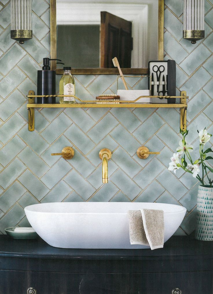 Winchester mint brick/subway tiles are shown here in a contemporary chevron pattern with luxurious gold grout. This image was styled by Marisa Daly for Homes & Gardens, August 2014.