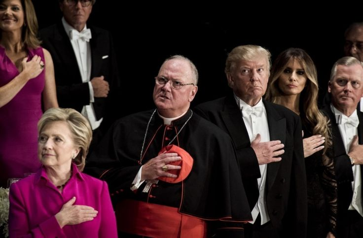 "Oct 20. An awkward night of jeers and barbs as Clinton and Trump share yet another stage for charity - The Washington Post caption: ""Democratic presidential nominee Hillary Clinton attends the 71st annual Alfred E. Smith Memorial Foundation dinner, along with Republican nominee Donald Trump and his wife, Melania Trump. In between them is Cardinal Timothy Dolan, archbishop of New York. (Melina Mara/The Washington Post)"""