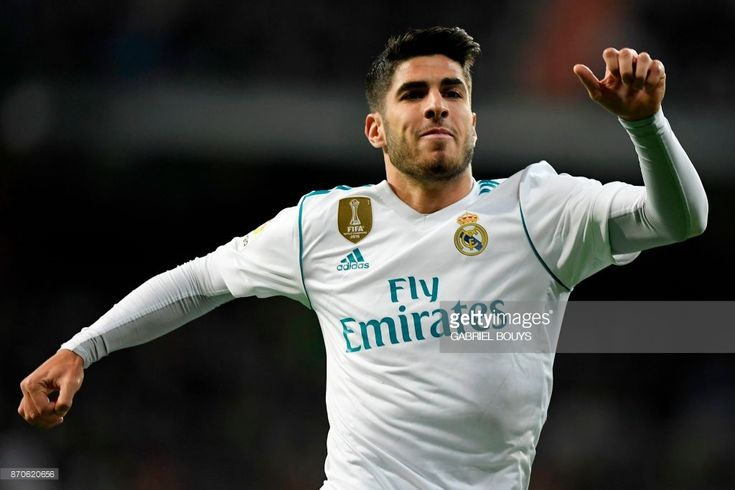 Real Madrid's Spanish midfielder Marco Asensio celebrates after scoring a goal during the Spanish league football match Real Madrid CF vs UD Las Palmas at the Santiago Bernabeu stadium in Madrid on November 5, 2017. /