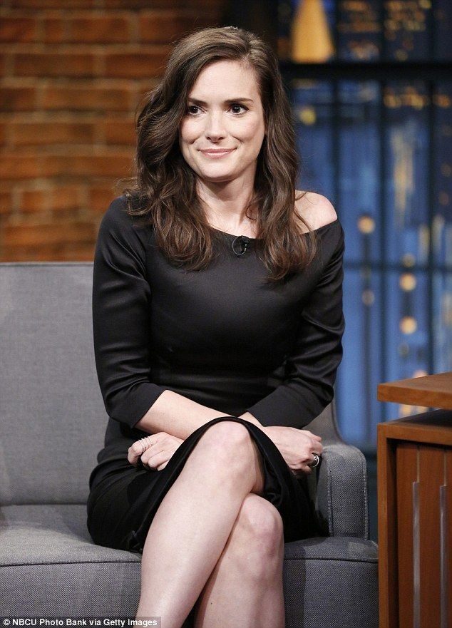 Stunning: The 43-year-old actress wore a little black dress and her hair down as she joked with Seth
