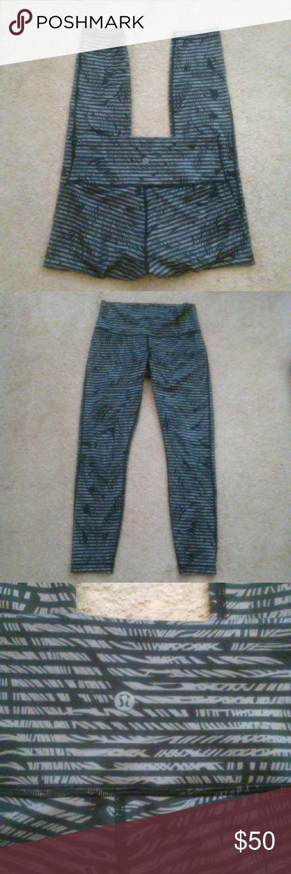 Lululemon Leggings High waist. No pockets. Black/gray design. Nylon/spandex. Size tag removed.  Excellent condition. lululemon athletica Pants Leggings