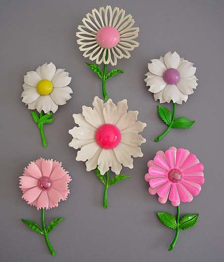"""Enamel """"flower power"""" brooches - 1960s   my mom has at least 3 of these brooches. she wore them on her vest to work at Macy*S.. where she bought them...love this"""