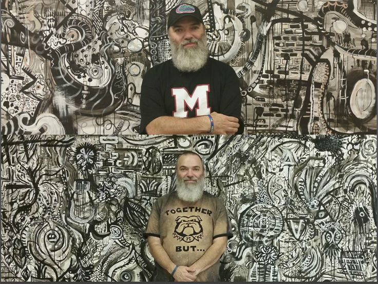 """Ty Manning in front of two """"sumi ink"""" murals created by his students (Capstone Project 2017)"""