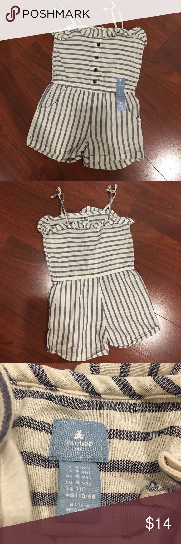 GAP Girls Striped Romper GAP Denim and cream striped romper. Girls size 4 years. Brand new with tags. Cute straps for shoulders tie with bows at the top. If only I had a daughter who would fit into this! lol Extremely CUTE outfit!! GAP One Pieces