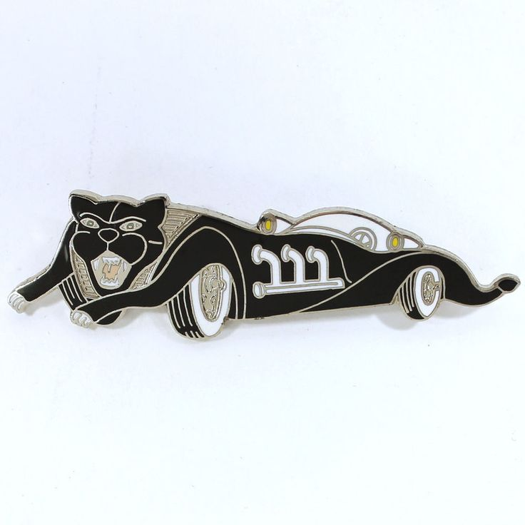 """Originally produced by ACME in 1988, Bob Kane (the creator of Batman) designed a collection of enamel jewelry for ACME Studio, creating original super hero characters in the process. This piece is the """"Panther Car"""" brooch. 