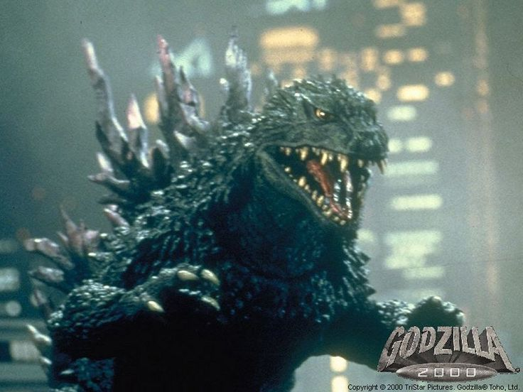 This is Godzilla, epic and eternal badass.   Godzilla was seriously one of my first words.  I have fond memories of sitting in my uncles lap waaay past my bedtime watching Godzilla take on everybody.