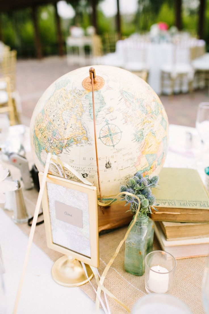 Globe as part of a centerpiece- love! // Photographer: Melissa Biador, Wedding Planner/Coordinator: Joyful Weddings & Events , Flowers & Decor: Forever Vintage Rentals, see more: http://theeverylastdetail.com/blush-vintage-travel-themed-wedding/
