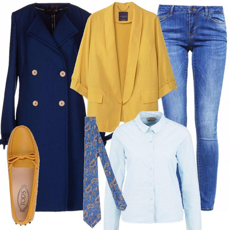Un look ordinato ma pieno di colore per un'ultima sessione d'esame prima delle feste: jeans azzurro a sigaretta, con camicia azzurra e blazer di un bel giallo intenso. Ai piedi non la solita scarpa: un mocassino in pelle, impermeabile, giallo come il blazer. A completare il look una cravatta con base azzurra e stampe sul giallo e un cappotto blu dal taglio marinaresco.
