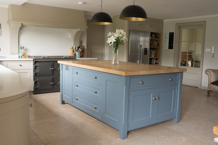 Plain and simple English Kitchen. The canopy designed to keep the surfaces fully available to left and right of the Aga