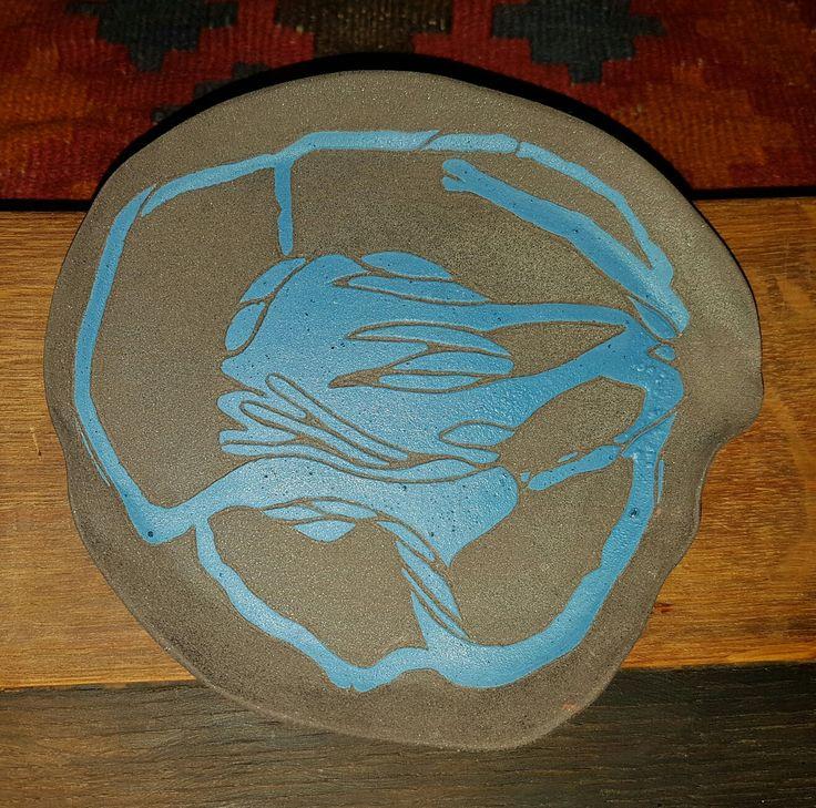 blue underglaze on black clay