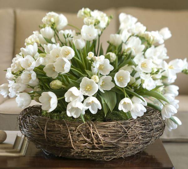 White tulips in woven nest bowl